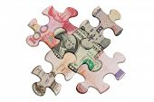 stock photo of superimpose  - Jigsaw puzzles superimposed with world major currencies - JPG