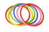 picture of hula hoop  - multicolor plastic bangles arranged on white background - JPG