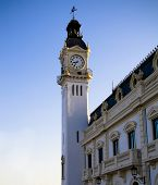 Valencia port tower with a clock and a bell