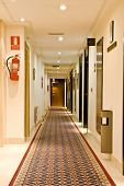 Corridor view of a new Spanish hotel .