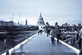 Blurred people on the Millennium bridge, London.