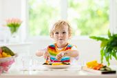 Baby Eating Vegetables. Solid Food For Infant. poster
