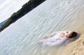Young woman floating in nature