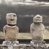 Two Moai In Easter Island Against Grey Sky