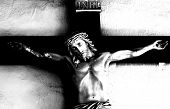 Black and white abstract image of Jesus on the Cross. Image shot at Mission De Alcala in San Diego,