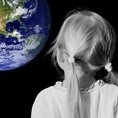 Little Girl Dreaming - female in black and white, earth colored. Earth courtesy of NASA via public d