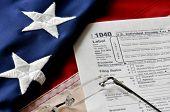Tax Season - US 1040 Individual Tax Form and American Flag