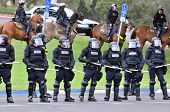 Holding the line - Police officers on foot and horseback