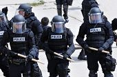 Police officers in riot gear - quelling the unrest
