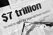 Troubled days on wall street - black and white concept image of headlines and reading glasses. Headlines read: $7 Trillion: No end in sight to year old bear market.
