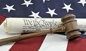 We The People - US Constitution, gavel, and American flag