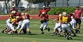 SAN MARCOS, CA - AUGUST 22: Running back hits the hole between blockers during a scrimmage of the Mi