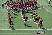 SAN MARCOS, CA - AUGUST 22: Members of the Mission Hills High school varsity football team take the field on August 22, 2009 in San Marcos, California.
