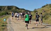 TEMECULA, CALIFORNIA - MARCH 28: Participants at the Columbia Sports Muddy Buddy ride and run series