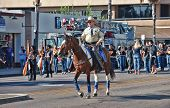 ESCONDIDO, CA - SEP 11: Members of an equestrian unit participate in the Grape Day parade on September 11, 2010 in Escondido, CA.
