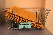 image of interoffice  - a Closeup of an office mail basket - JPG