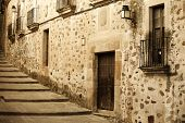 Antique medieval street at Unesco city of Caceres.