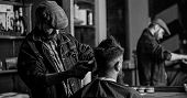 Reflexion Of Barber With Clipper Trimming Hair Of Client. Hipster Client Getting Haircut. Hipster Li poster