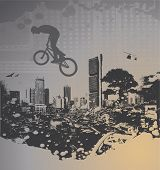guy with bmx on city landscape with splash