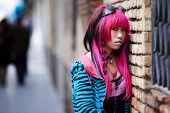 Young thoughtful pink haired asian portrait