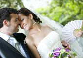 stock photo of wedding couple  - Groom kissing bride on their wedding day - JPG