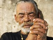 Senior African man with folded hands - focus on the weathered hands