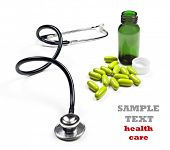 a Doctor's stethoscope and pill bottle with pills on a white background with space for text