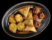 Selection of Indian samosa, bhaji and pakora