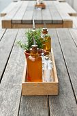 Wooden Table With Oilers And Salt Shaker In A City Outdoor Cafe