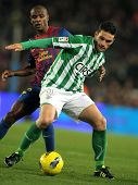 BARCELONA - JAN 15: Jorge Molina(R) of Real Betis vies with Eric Abidal(L) of FC Barcelona during th