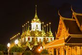 View Of The Old Chedi Loha Prasat (the Metal Temple) In The Night Landscape. Bangkok, Thailand poster