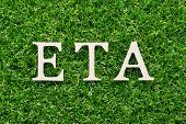 Wood Alphabet In Word Eta (abbreviation Of Estimated Time Of Arrival) On Artificial Green Grass Back poster
