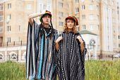 Young rastafarian couple on a city street