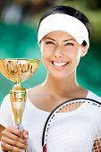 stock photo of won  - Tennis player won the cup at the sport match - JPG