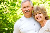 picture of elderly couple  - Smiling happy elderly couple in love in the forest - JPG
