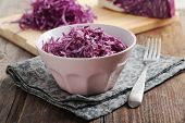 Red coleslaw on a rustic table