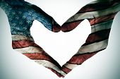 man hands painted as the american flag forming a heart