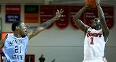 NEW YORK-NOV 3: St. John's Red Storm guard Phil Greene IV (1) shoots over Sonoma State Seawolves gua