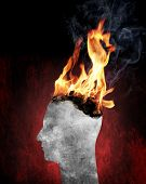 Conceptual image of a head burning in flames.