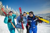 Portrait of couple of skiers standing on ski slope