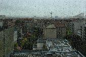 Rain Drops On A Window With City Landscape