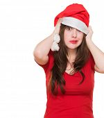 worried woman wearing a christmas hat against a white background