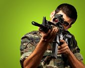 Soldier Gunman Aiming His Target On green Background