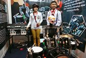 SUBANG JAYA - NOV 10: Unidentified students from Thailand show their music robots at the World Robot
