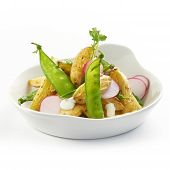 delicious potato salad with raddish and sugarsnaps