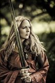 Sexy Woman Warrior With Sword Outdoor