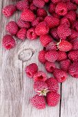 Sweet raspberry on wooden tables