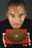 Close up of Man holding Feng-Shui-Diagramm