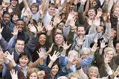 stock photo of stand up  - High angle view of group of happy multiethnic people raising hands together - JPG