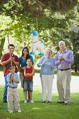pic of pinata  - Family watching boy hitting pinata - JPG
